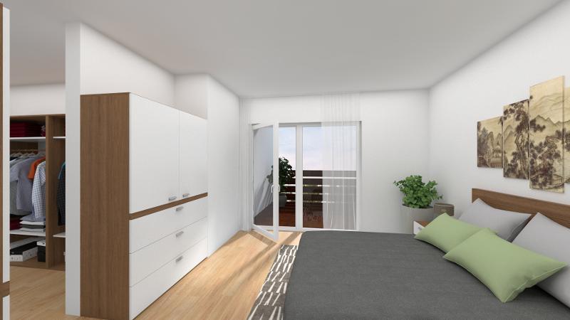 Elternschlafzimmer mit Ankleide und Zugang zum Balkon